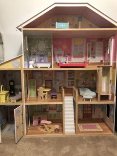 4ft tall doll house with furniture and working elevator