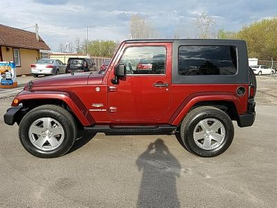 2009 Jeep Wrangler Sahara (Red Rock Crystal Pearl)