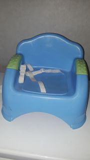 Booster seat with all straps.