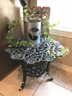 Rod iron table with chippy accents. Love this table but no longer need. Can be painted to any color desired. Heavy duty.