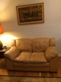 Tan leather loveseat