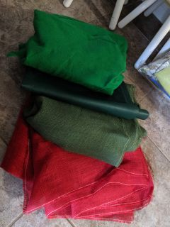 Green felt and other fabrics used in bulletin board