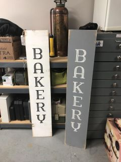 Gray and White Bakery Sign
