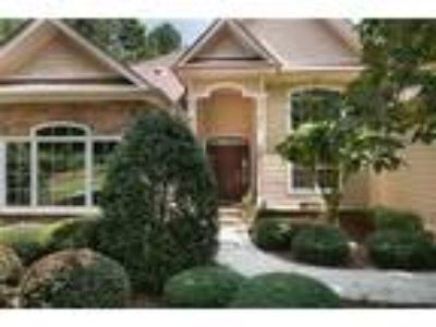 Main level living in a private wooded setting...