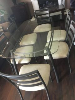 Glass/ metal kitchen table and 6 chairs