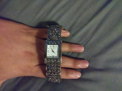 Embossed watch
