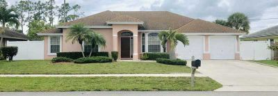 102 Brook Woode Court Royal Palm Beach Three BR