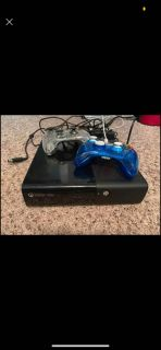 Xbox 360E Console with 2 Light up Controllers and all cords