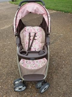 Graco stroller, brown with pink flowers. Used but great condition.