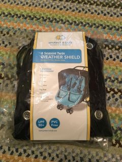 New! Never opened. Double stroller or jogger w canopy weather shield