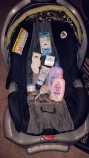 GRACO CAR SEAT AND INCLUDES NEW MISC BABY ITEMS