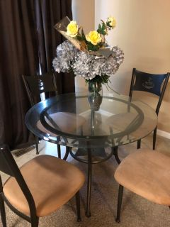 Glass table and four chairs. Delivery unavailable.