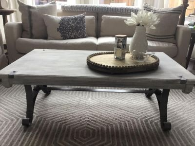 Custom painted heavy solid wood and iron coffee table. 49.5X28-1/4X17.5H. $315 Cross post