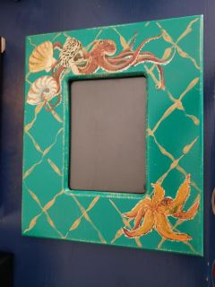 Hand painted picture frame 10x12 holds a 5x7 picture. Shells, starfish octopus $2.00