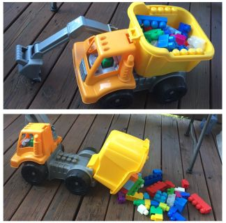 "HUGE - MEGA BLOCK DUMP TRUCK WITH MOVABLE LOADERINCLUDES 45 MEGA BLOCKSEXTENDED IS 24""GREAT GIFT"