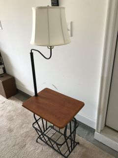 End table/nightstand with lamp and magazine rack.