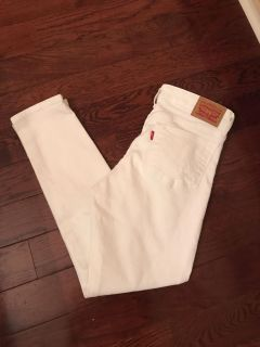 Levis skinny 711 size 28 white distressed jeans. 27 inch inseam. Worn once.