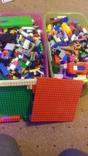 2 5.2 quart tubs of legos different car/boat pieces lego guys and much more all for 25.00
