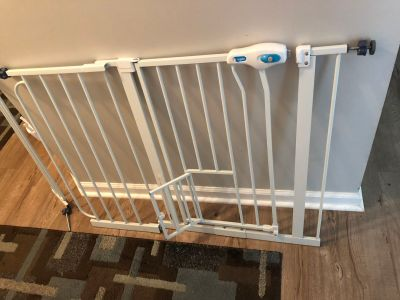 Baby gate with pet walk thru