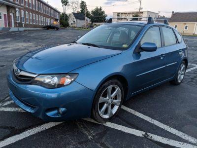 2010 Subaru Impreza Outback Sport (Newport Blue Pearl With Steel Silver Met)