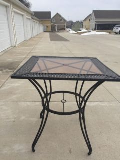 Wrought iron bar height patio tsble