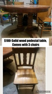 $100- Solid wood pedestal table comes with 3 chairs