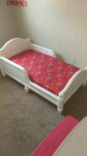 A toddler bed and a toddler table take table outside or indoor