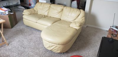 Leather matching couch and chair plus tv stand
