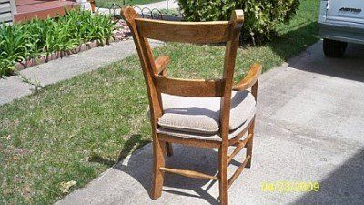Wooded arm chair padded seat