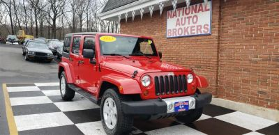 2011 Jeep Wrangler Unlimited Sahara (Flame Red Clear Coat)
