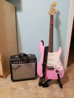 Pink Electric guitar with Amplifier