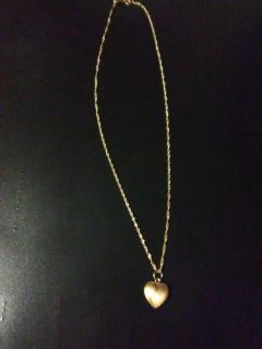 14k small heart pendant on 10k gold chain