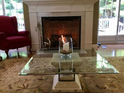 SEE ALL 5 PICS. Fabulous glass, faux stone coffee table