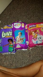 Pull ups unopened size 3T-4T.. Swimmers out of the 11 in the bag 7 left size Med weight 24-34#s... 11 out of 17 diapers size 6...
