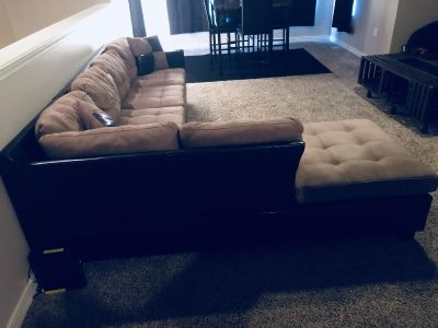Black and Light Brown sectional couch.
