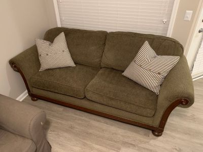 Nice grey couch with wooden accents