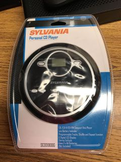 NEW! Sylvania Personal CD Player with earbuds. Uses 2 AA Batteries NOT INCLUDED