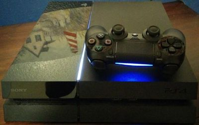 $350, Sony PlayStation 4 PS4 new revision CUH-1115A, black with 5 games