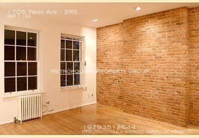 Large two-bedroom features exposed brick walls, high ceilings and hardwood floors. Located between 88th and 89th Streets