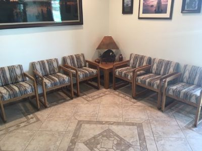 Waiting room furniture six chairs and two corner tables