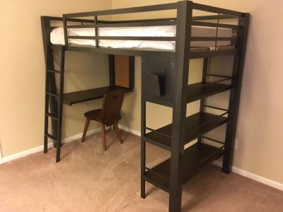 Very sturdy metal framed loft bed with desk and book shelves.