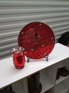 Beautiful red plate on easel with candleholder