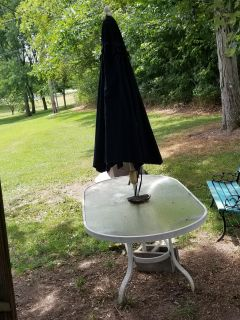 Outside glass table and umbrella