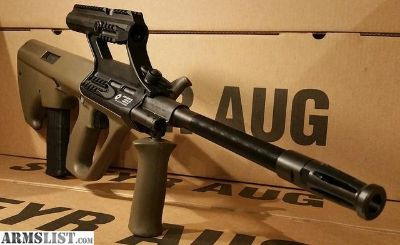 For Sale: 20 INCH Barrel AUG accepts AR 15 mags 3.0x Scope