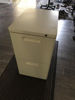 PICK UP TODAY FOR BETTER DEAL. Extremely heavy duty (so does not tilt with heavy items in it as it is weighted) filing cabinet.