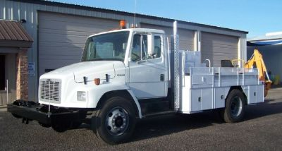 2003 Freightliner with backhoe attachment