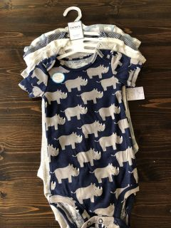 New with tags set of Carter 5 onesies.