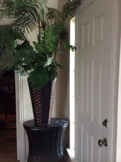 Fake plant decor and stone stand