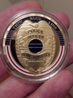 LARGE 40mm POLICE OFFICER SERVE AND PROTECT THIN BLUE LINE COIN.