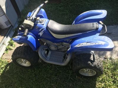 Power wheels four wheeler with charger